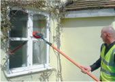 Cleaning windows with a water fed pole